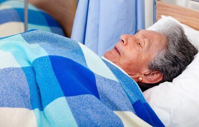 elderly lady in a bed