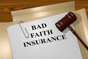 Bad faith insurance documents and a gavel.