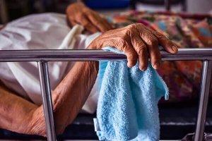 Elderly lying in bed in a nursing home in Louisville