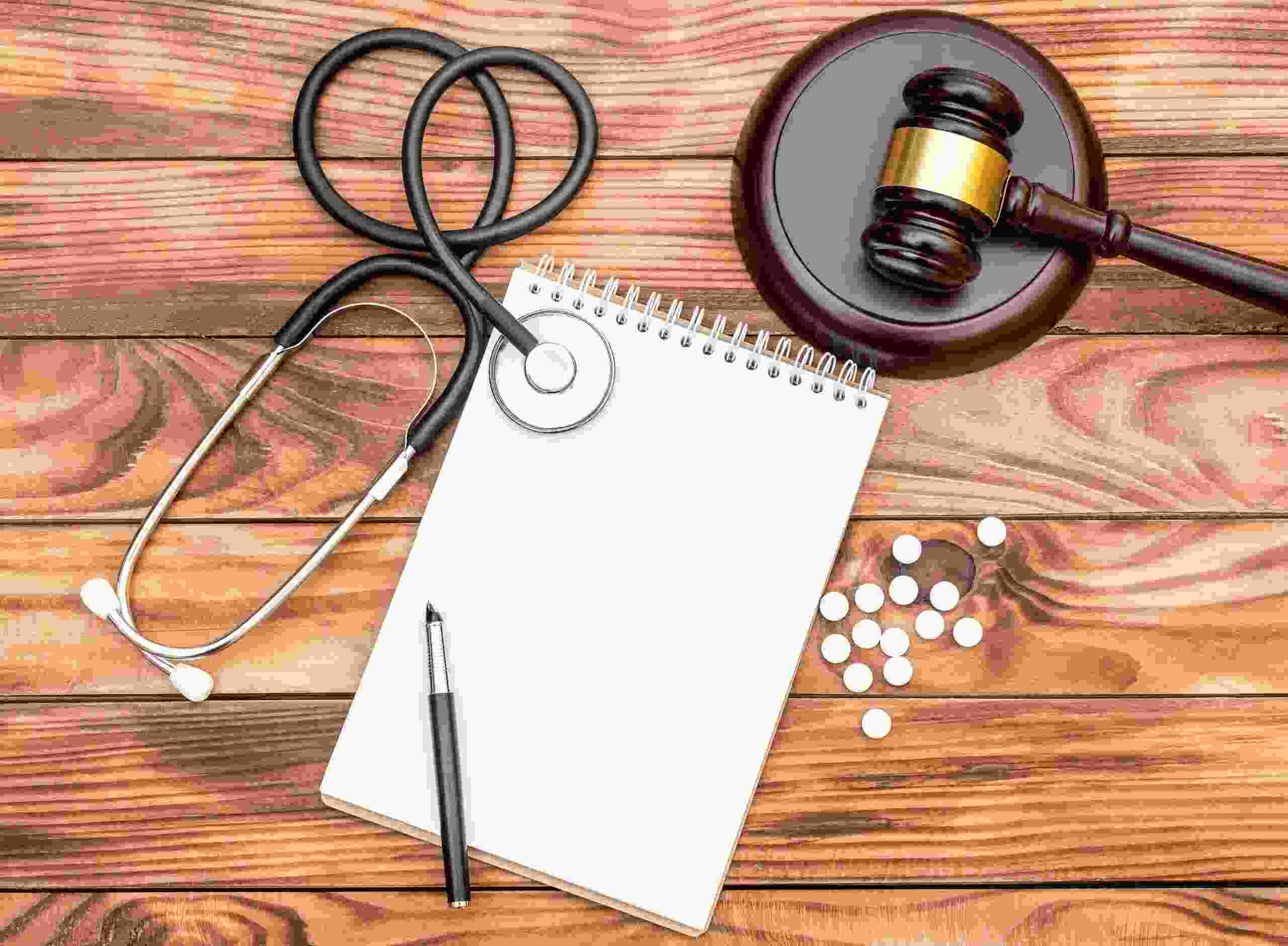 Gavel, medication, and stethoscope.