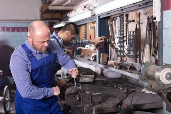 Men-repairing-in-a-mechanic-shop