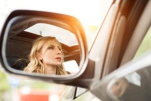 A woman driving a car.